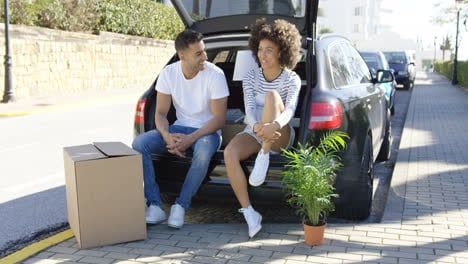 Young-couple-relaxing-while-moving-house