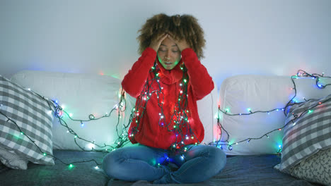 Tired-woman-trying-to-untangle-garland