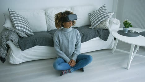 Woman-in-VR-glasses-at-home