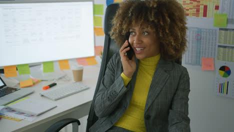 Cheerful-elegant-worker-talking-on-phone