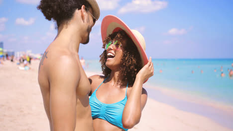 Laughing-couple-standing-on-shore