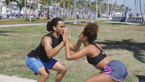 Couple-knee-bending-and-working-out