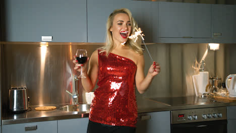 Cheerful-woman-with-wine-and-sparkler