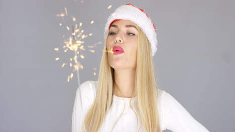 Pretty-blond-girl-enjoy-christmas-with-sparkler