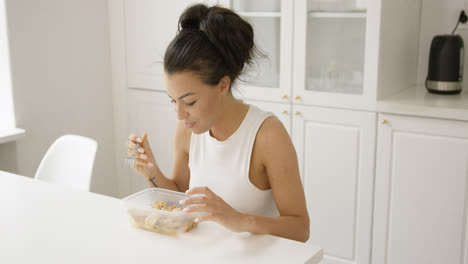 Young-girl-eating-from-container