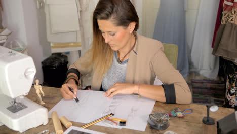 Female-dressmaker-drawing-sketches