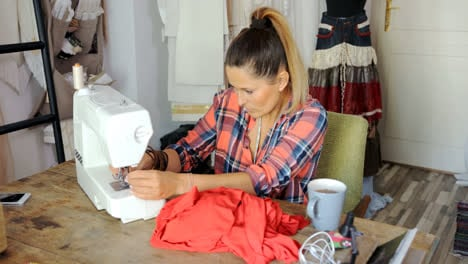 Young-female-sewing-dress