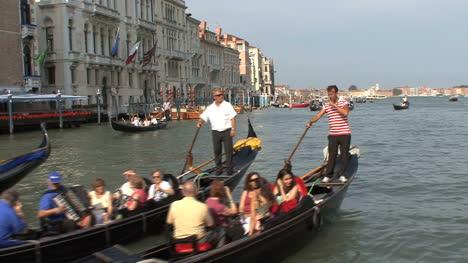 Venice-Three-gondolas-full-of-tourists