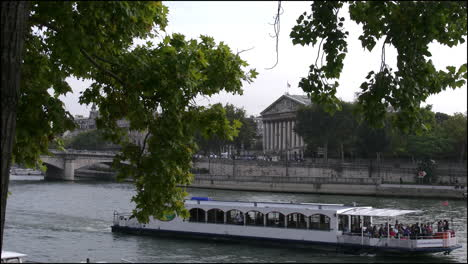 Paris-National-Assembly-beyond-boat-going-by