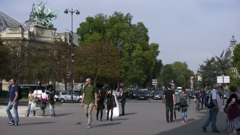 Paris-street-scene-with-bride-and-pedestrians