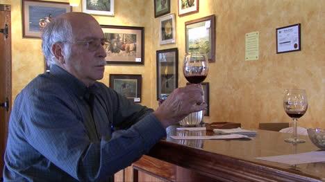 Nebraska-man-samples-red-wine