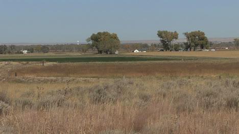 Nebraska-farm-with-distant-train