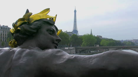 Paris-Eiffel-Tower-from-statue-with-gold-crown-on-Pont-Alexandre-III-pan