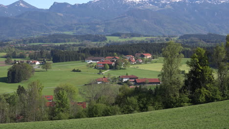Germany-village-with-Alps-beyond-zoom-in