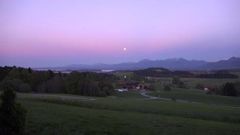 Germany-zoom-in-to-full-moon-over-village