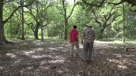Louisiana-man-and-boy-walking-in-woods