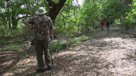 Louisiana-man-waits-for-woman-and-boy-in-woods
