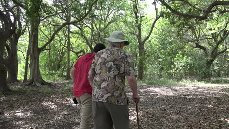 Louisiana-man-with-cane-and-boy-in-woods