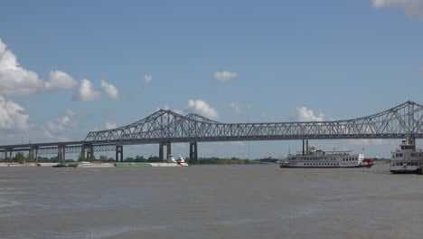 New-Orleans-bridge-with-barge-and-steamboat
