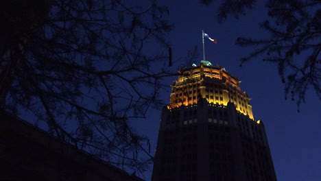San-Antonio-tower-with-flag-at-night