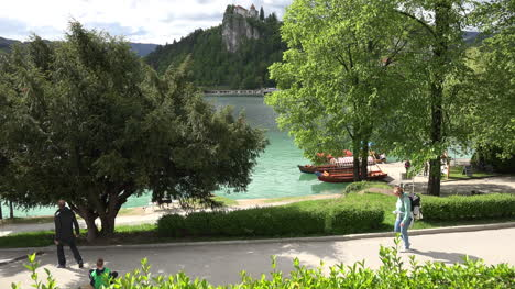 Slovania-backpacker-walks-by-Lake-Bled