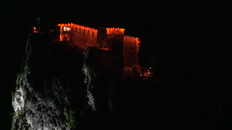 Slovenia-castle-lit-at-night-at-Bled