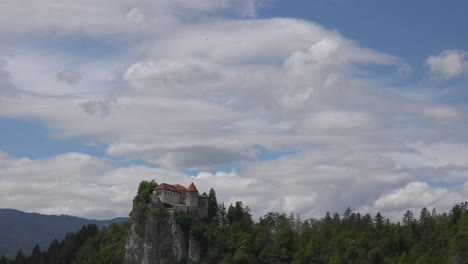 Slovenia-clouds-moving-above-castle-at-Bled-time-lapse