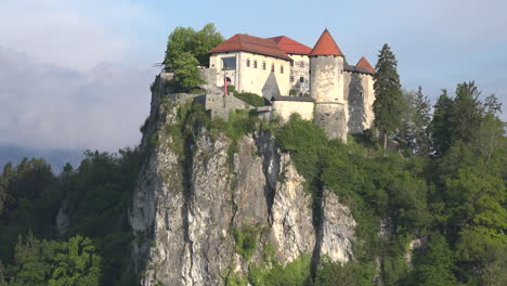 Slovenia-dramatic-rock-crowned-by-castle-above-Bled