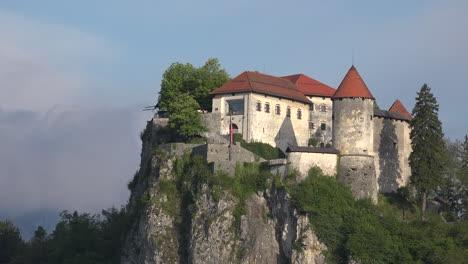 Slovenia-morning-light-on-castle-above-Bled