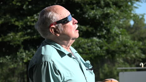 Solar-eclipse-watched-by-elderly-man
