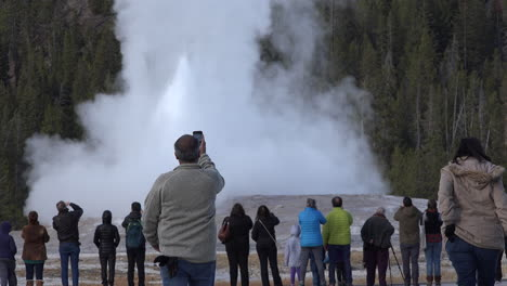 Yellowstone-man-approaches-Old-Faithful-eruption-with-camera-phone