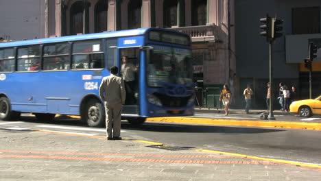 Ecuador-Quito-buses-pass-by