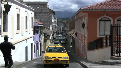 A-taxi-drives-up-a-street-in-Ecuador