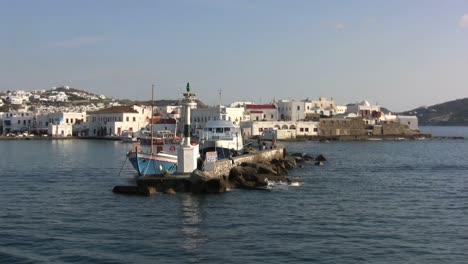 Passing-a-lighthouse-on-a-Greek-island-of-Mykonos