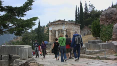Tourists-walking-toward-the-Treasury-at-Delphi