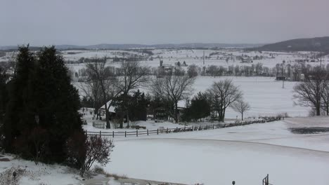 Snowy-landscape-with-farmstead