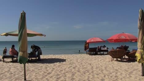 Cambodian-beach-with-umbrellas