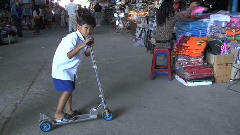 Cambodia-market-boy-on-scooter