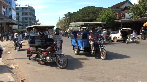 Cambodia-street-with-motor-cabs