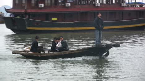 Halong-Bay-with-men-in-a-small-boat