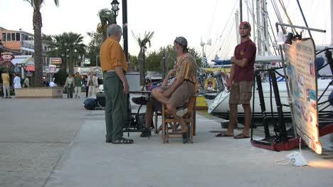 Tourist-and-local-men-bargining