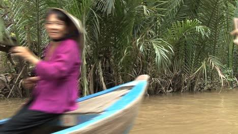 Vietnamese-paddling-canoes