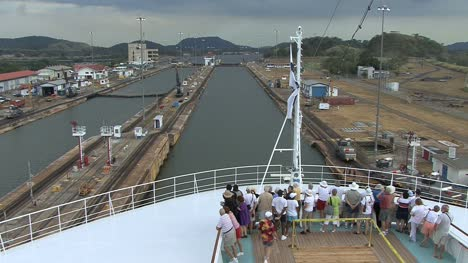 Panama-Canal-Miraflores-Locks-with-passengers-and-flag
