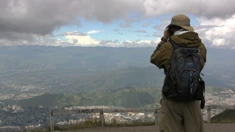 Ecuador-Tourist-photographing-mountain-scene