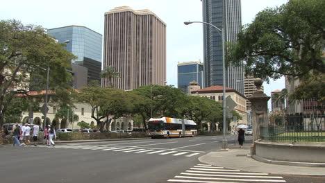Honolulu-crossing-street-and-tall-buildings-2