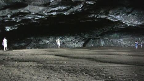 Kauai-People-walking-in-a-sea-cave