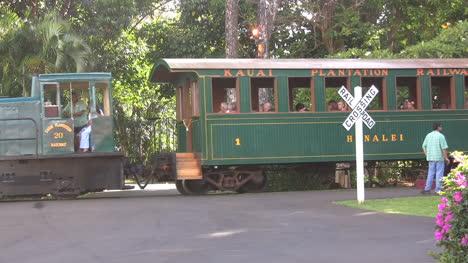 Kauai-plantation-train-goes-by-a-rail-crossing-sign