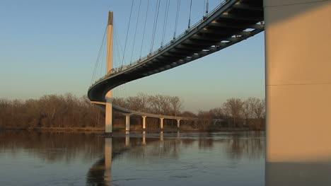 Omaha-footbridge-dog-walking-shadow