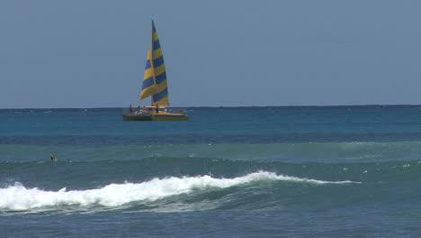 Waikiki-sailboat-and-waves-on-reef