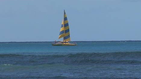 Waikiki-sailboat-surfers-and-waves